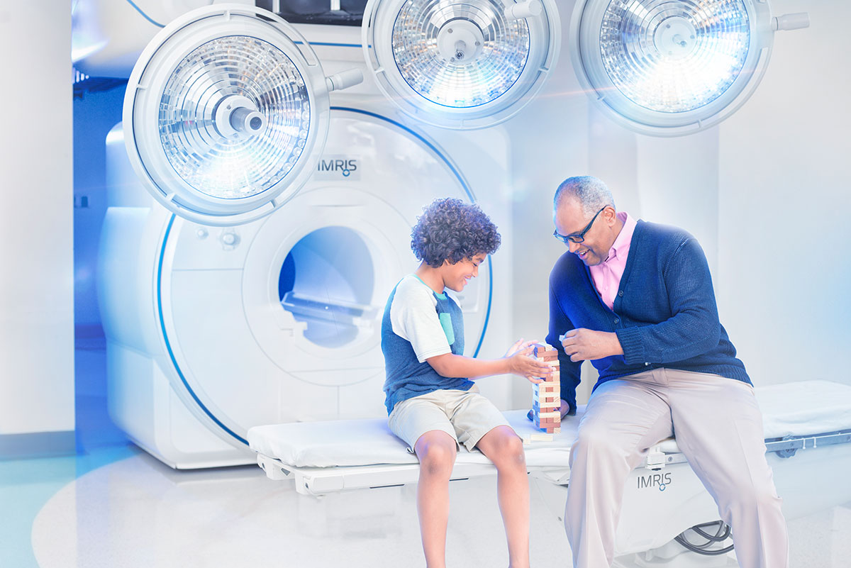 Grandfather and grandson in IMRIS Surgical Theatre